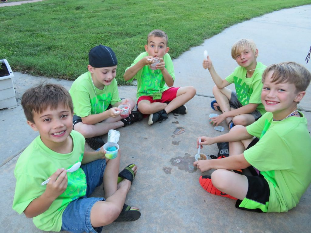 Boys eating ice cream at camp